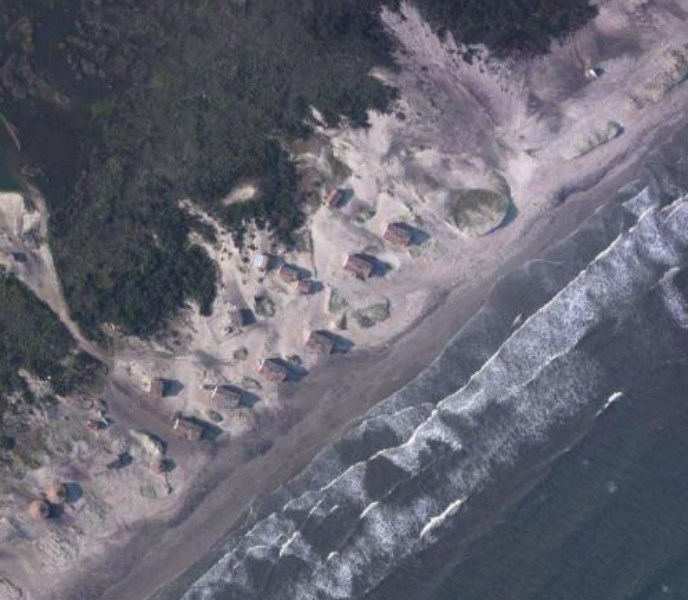 Cabins at Cape Lookout are dangerously close to the coastline as sea levels continue to rise