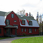 Roosevelt's red cottage with green trim