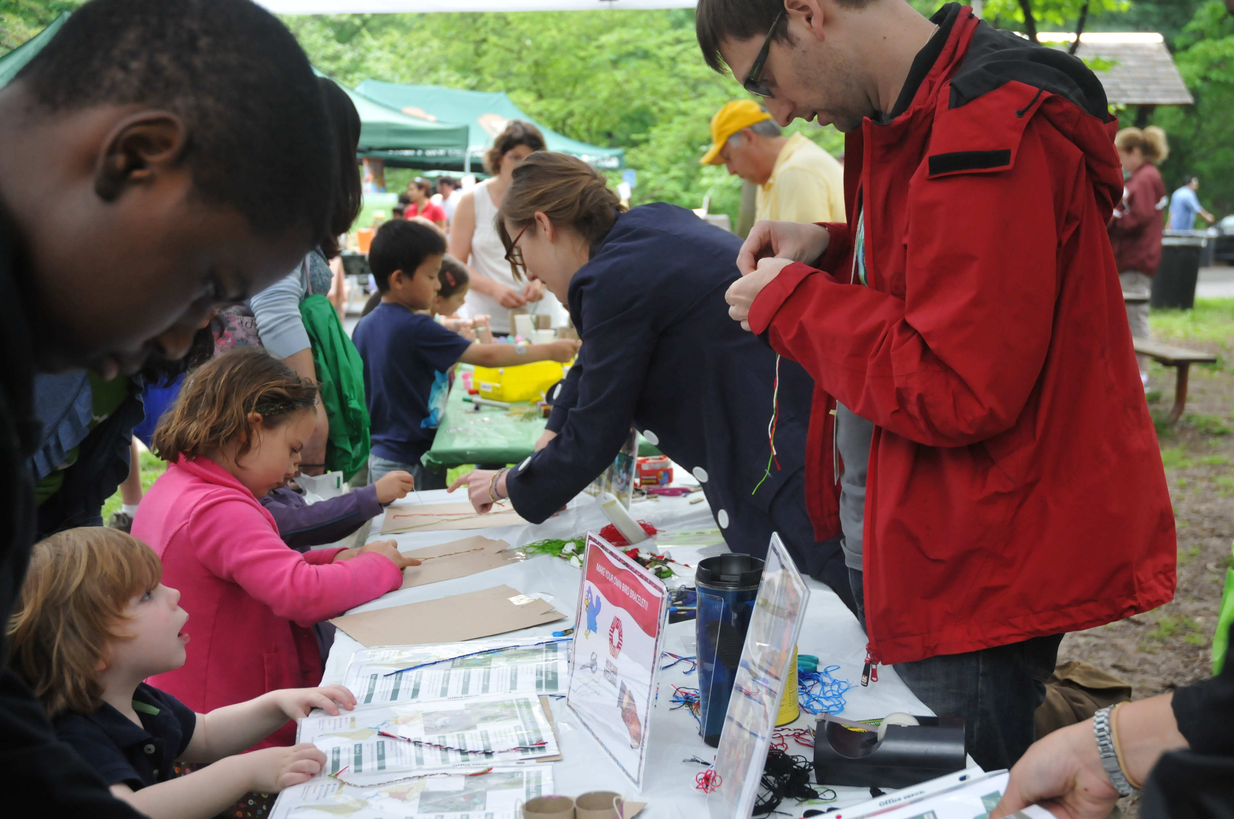 International Migratory Bird Day visitors gather around craft tables