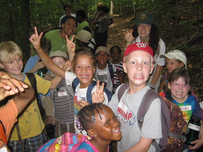 Kids in a group smiling at Junior Ranger camp