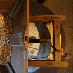 A look downwards at the mill stone and corn feeder at Peirce Mill.