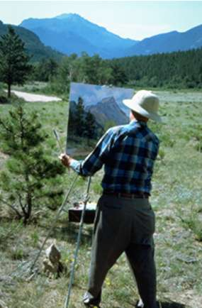 Photo Plein Air artist painting in a meadow at Rocky Mountain National Park.