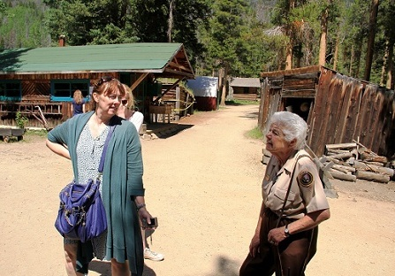 Diane Phillips talks to a group after they walk through Mama Cabin