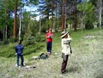 a photo of volunteers listening for olive-sided flycatchers