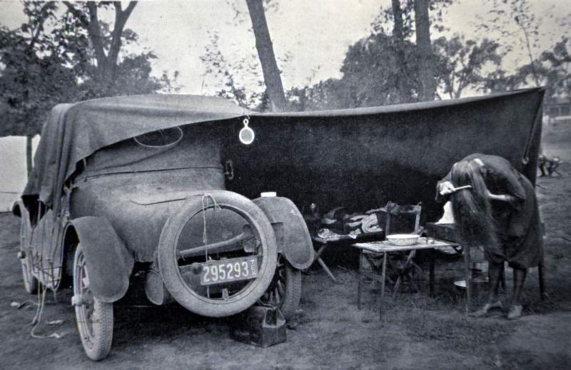 "a photo of vintage ""car camping"""