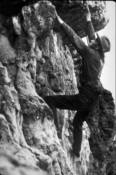a vintage photo of a mountain climber
