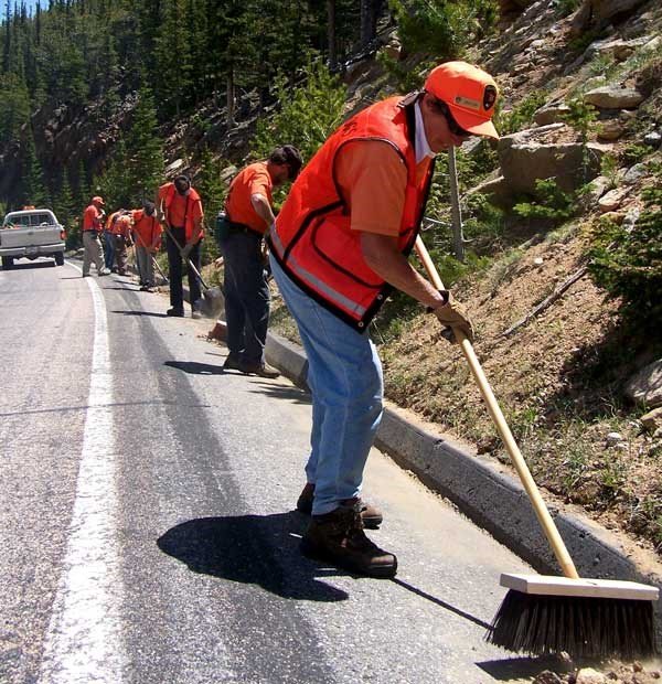 a photo of road hogs working on culverts and ditches