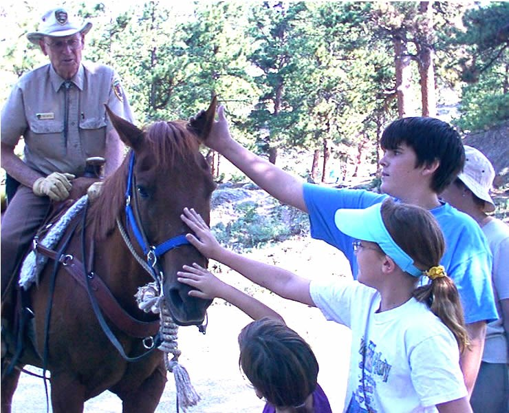a photo of a park volunteer on horse patrol