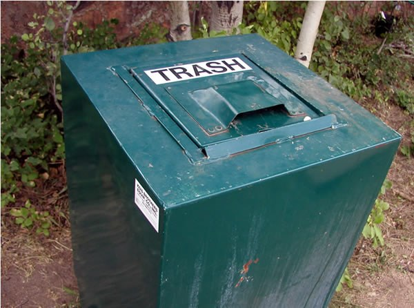a photo of a bear proof trash can