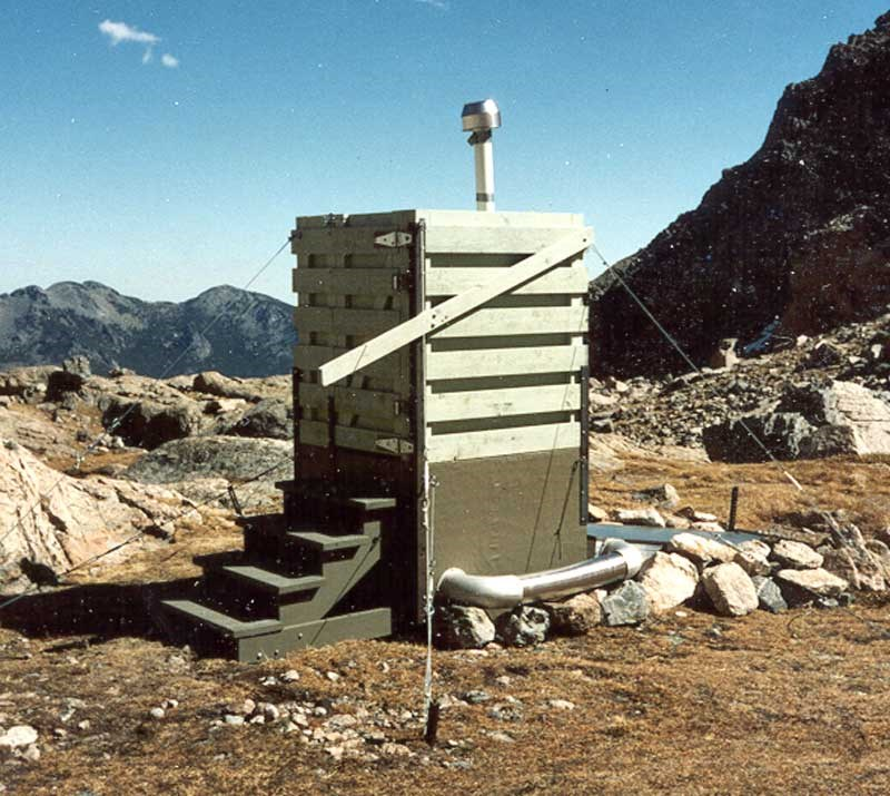 a photo of a backcountry toilet
