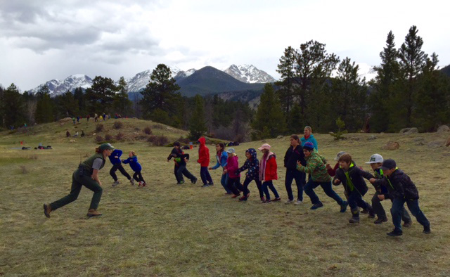Students play an educational game on a field trip to Rocky Mountain National Park.