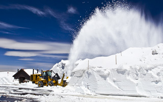 Snowplow plows snow at Alpine Visitor Center