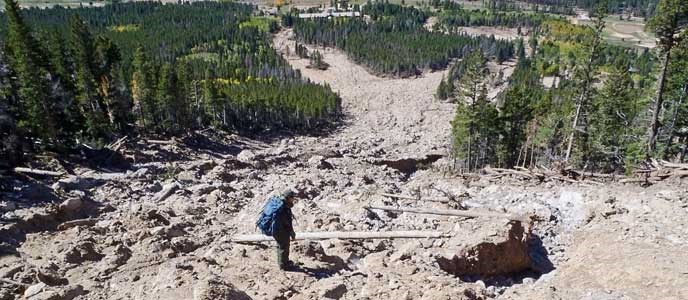 A park ranger stands on the Twin Sisters debris flow