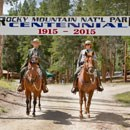 Park Rangers on Horseback underneath a Centennial Banner