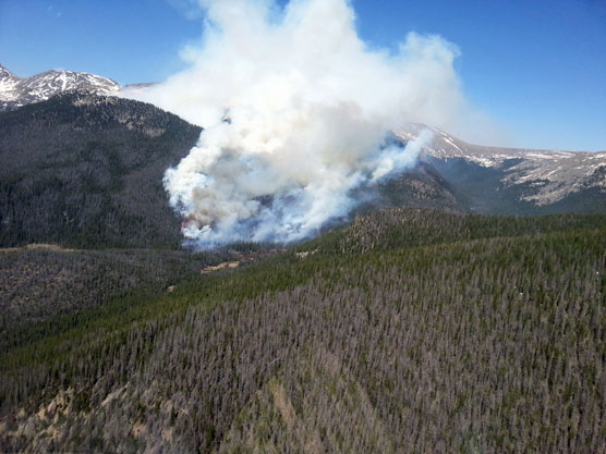 Photo from flight over the Big Meadows Fire on the afternoon of June 11, showing smoke and flames in the distance.