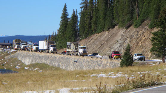 A nine vehicle convoy of tractor trailers, a truck mounted rock crusher, pickup trucks and pilot vehicles cross Trail Ridge Road in Rocky Mountain National Park today.