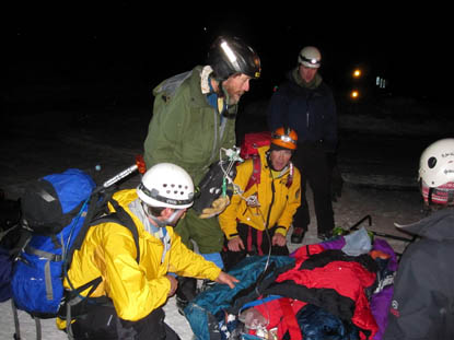 Photo Rescue team with injured skiier at the Bear Lake Trailhead following his evacuation from the backcountry in Rocky Mountain National Park.