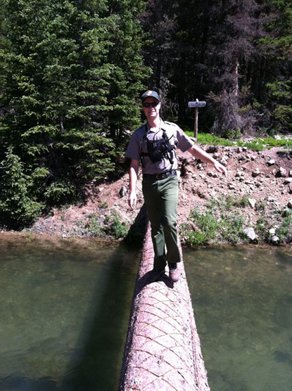 Backcountry Ranger on footbridge in Rocky Mountain National Park.