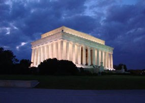 Lincoln Memorial glowing with lights at night in Washington DC