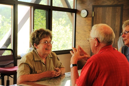 Betsy Leverton talks to visitors about driving over Trail Ridge Road.