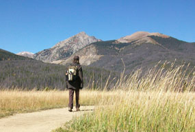 Fall intern of Rocky Mountain National Park walking in the Kawuneeche Valley.