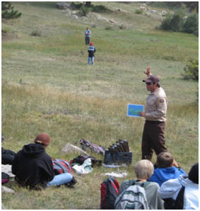 Photo Heart of the Rockies Environmental Education Intern Curtis teaching kids about geologic time