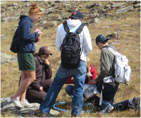 Photo Jessica on the alpine tundra with biology students.