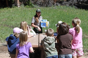 Ranger Chelsea gives a program to a group of children.