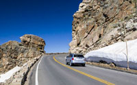 Car approaches Rock Cut on Trail Ridge Road