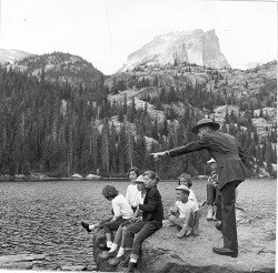 Ranger and visitors at Bear Lake 1960 credit NPS 250X246