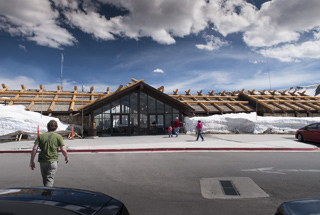 Photo of Alpine Visitor Center in early June with snow up to the roof.