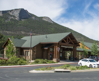 Photo of Fall River Visitor Center with Deer Mountain in the background.