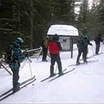 xc skiers at Emerald Lake