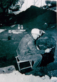 Paul H. Brown excavting in Russell Cave