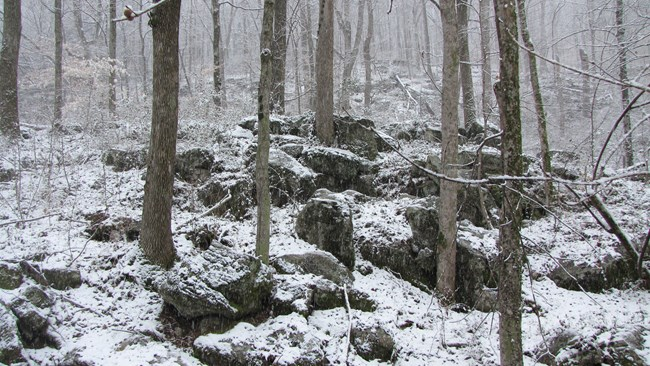 snow along the boardwalk to the cave shelter