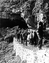 Visitors Exiting the Cave Shelter (circa 1960's)