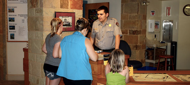 Visitors receiving information from Park Ranger