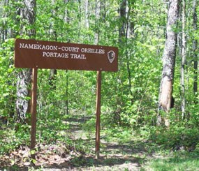 Sign identifies this trail in the woods as the Namekagon - Court Oreilles Portage Trail