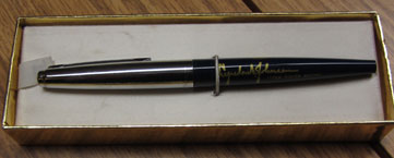 Silver and blue writing pen with signature of President Johnson