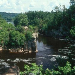 A wooded Cliff Rock outcropping on a river bend.