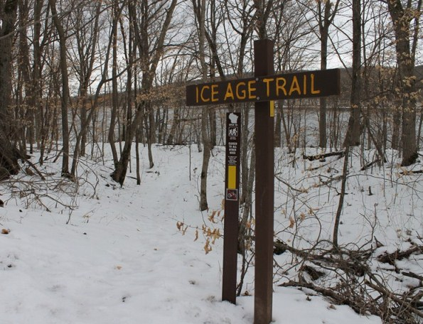 A sign denoting the Ice Age Trail is seen, with the St. Croix River in the background. (NPS photo)