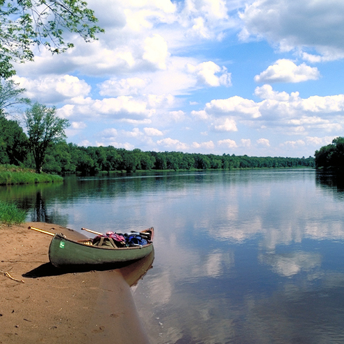 A canoe is pulled up to a sandbar on the lower St. Croix River in this image. NPS photo.