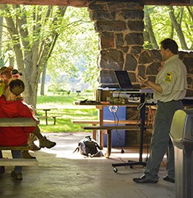 A Department of Natural Resources biologist talks at a state park.