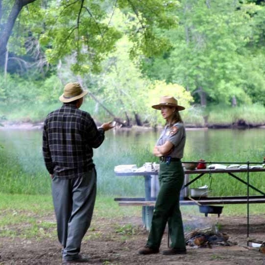 A Park Ranger shares stories of the river with a park visitor. NPS photo