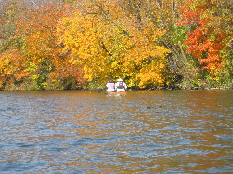 Two canoers enjoy the fall colors on the St. Croix. NPS photo.