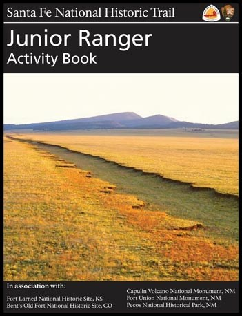 front cover of Santa Fe NHT Junior Ranger Activity Book with cover image of a dirt road crossing an open plain
