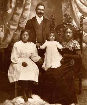 A formal portrait of Captain Shorey with his wife and two children.