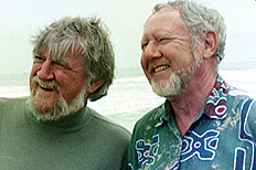 A color photo of two smiling men with beards.