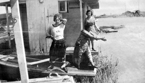 Three women on a houseboat in Alviso, CA in 1915. SAFR B11.22,072n