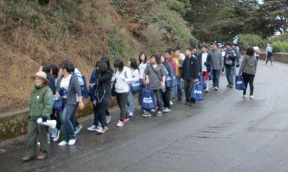 Group of students walking in the Fort Mason area.
